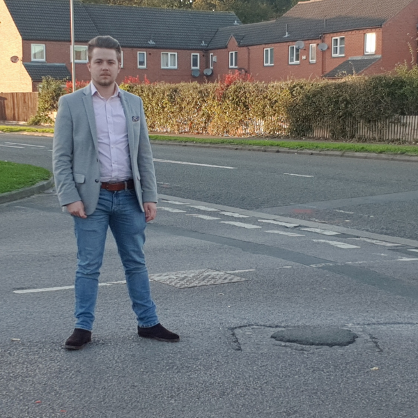 Liam Harries and Quedgeley pothole