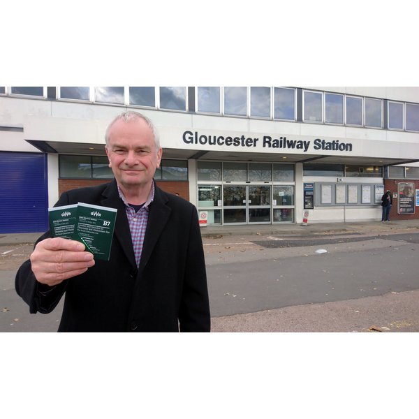 Jeremy Hilton at Gloucester Railway Station, with current timetable to London