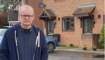 Declan Wilson outside affordable homes in Podsmead