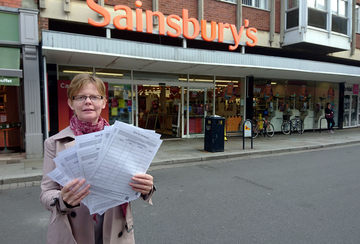 Rebecca Trimnell outside Sainsbury's with her petition