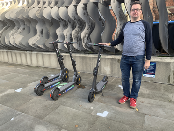 Councillor Sebastian Field with e-scooters