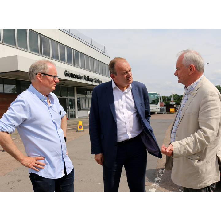 Photograph: Declan Wilson and Jeremy Hilton talk to Lib Dem leader, Ed Davey MP about the railway station upgrade plan. (July 2019)